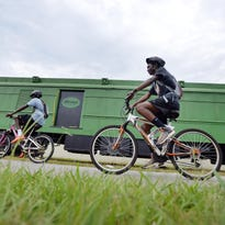 Bicyclists ride near the Swamp Rabbit Station along the Swamp Rabbit Trail near Sulphur Springs Road on Thursday, July 2, 2015.