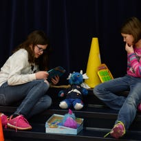 """Sarah Nieukirk, left, and Abigail Dalrymple play a game of """"Guess Who"""" Thursday, Feb. 4, 2016, for Global Play Day at Western Wayne Elementary School in Cambridge City."""