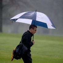 Golfers endure the rain for the Winchester Invitational Saturday, April 30, 2016, at the Winchester Golf Club.