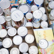 Canned goods are collected in a bin,
