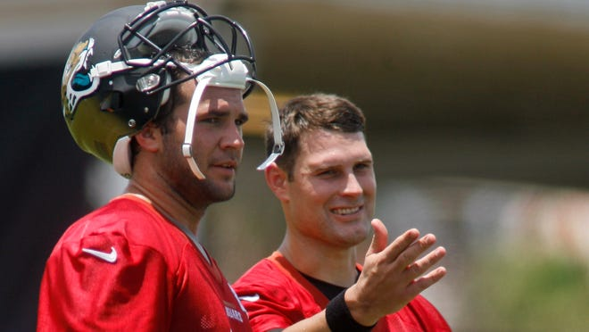 Jaguars QBs Blake Bortles and Chad Henne (7) talk during the team's minicamp Tuesday.