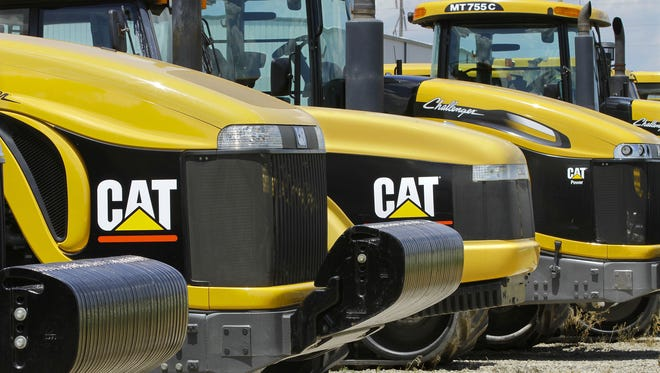 2012 file photo shows earth-moving tractors and equipment made by Peoria, Ill.-based Caterpillar Inc.