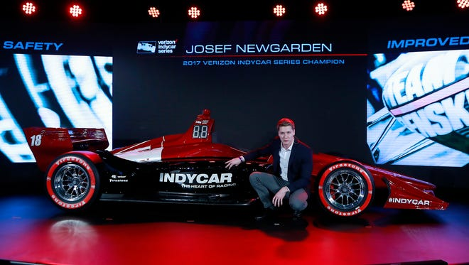 Josef Newgarden, 2017 Verizon IndyCar Series champion, describes the advantages of the new race car setup during the North American International Auto Show, Tuesday, Jan. 16, 2018, in Detroit.
