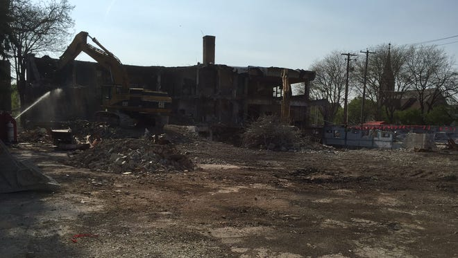 A former church and Boys Club building was razed this summer to make way for a 140-unit apartment proposal.
