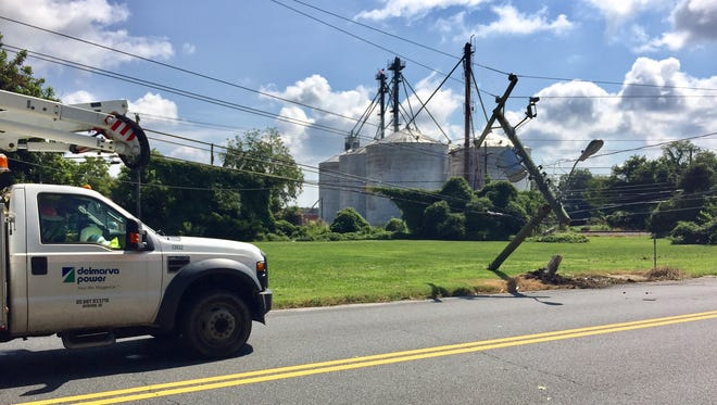 A Delmarva Power crew works to repair a utility pole that snapped and fell alongside South Somerset Avenue in Princess Anne when a vehicle struck it about 10:30 a.m. Thursday, Aug. 31, 2017. Somerset was closed between Hampden Avenue near the crash scene and Stewart Neck Road.
