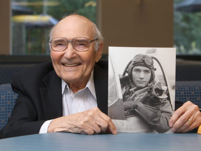 World War II veteran Bill Lyons of Irvington holds a photo of him taken in 1944 in England at Westchester Community College Aug. 28, 2014. Last year, he went to Washington D.C. to see the World War II monument as part of the Hudson Valley Honor Flight program.