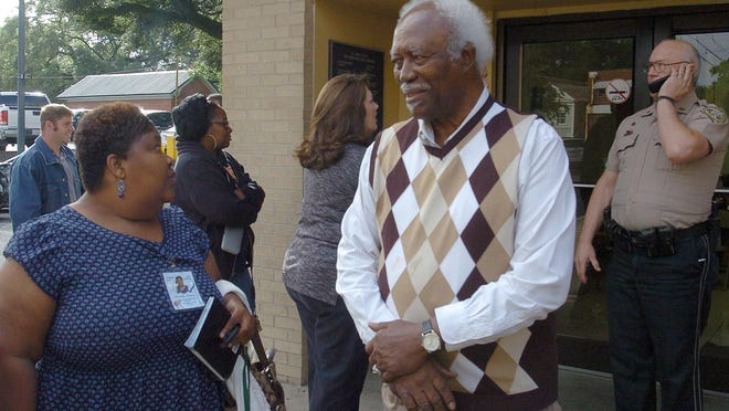 Chaterral Johnson and her father, Wilbert Johnson, wait outside the court annex building Wednesday where a court hearing for Harrison Riley was being held.
