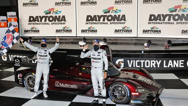 Drivers Jonathan Bomarito and Harry Tincknell celebrate in Victory Lane after winning the IMSA Weathertech 240 at Daytona International Speedway.