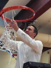 North Kitsap boys basketball coach Scott Orness cuts