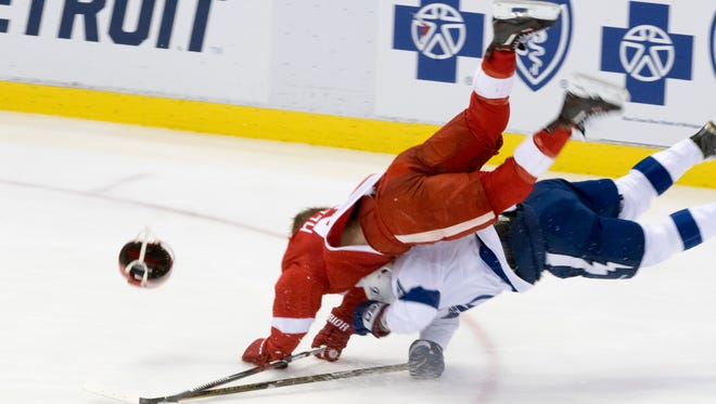 Detroit center Darren Helm flies over the top of Tampa Bay defenseman Nikita Nesterov after a collision in the third period. Abdelkader left the game due to an injury from the play.