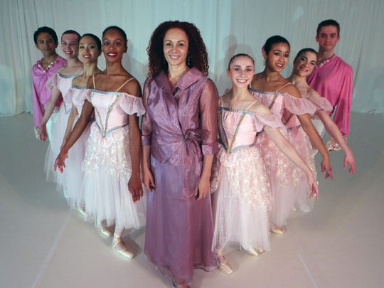 """Carole Alexis, choreographer and director of the Ballet des Ameriques with the company dancers, after a """"Nutcracker"""" performance."""