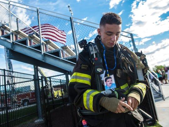 Shippensburg firefighter Richard Bucco gears up before