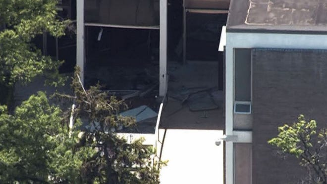 The front door of the WMAR television station is destroyed after a man rammed a truck into the building on May 13.