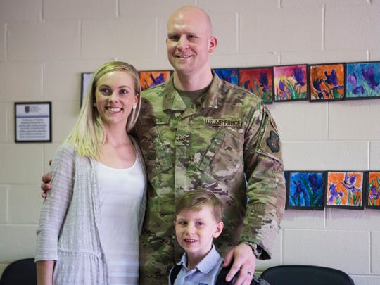 U.S. Air Force Technical Sergeant Khristian Pickett who was deployed and stationed in Tunisia and returned home yesterday, poses for a photo with his son Liam, 5, and wife Sami at Christian Academy of Knoxville, Thursday, May 3, 2018.