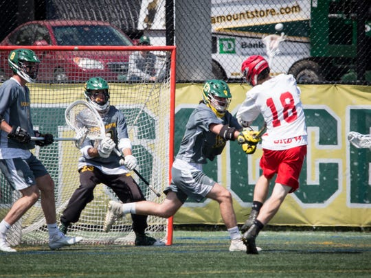 CVU's Will Braun fires during Saturday's Division I boys lacrosse final.