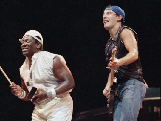 Clarence Clemons and Bruce Springsteen perform during