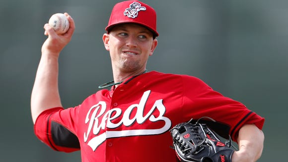 Reds pitcher Mike Leake throws live batting practice.