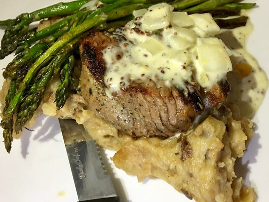 Filet mignon at Islands Fish Grill served with smokey mashed potatoes and asparagus.
