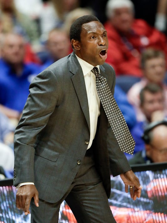 FILE - In this March 10, 2017, file photo, Alabama head coach Avery Johnson yells to his players during the first half of an NCAA college basketball game against South Carolina at the Southeastern Conference tournament, in Nashville, Tenn. Alabama basketball coach Avery Johnson has received a two-year contract extension through 2023. The board of trustees' compensation committee approved the extension on Friday, Aug. 4, 2017. Johnson will receive $2.9 million annually under the six-year deal. (AP Photo/Wade Payne, File)