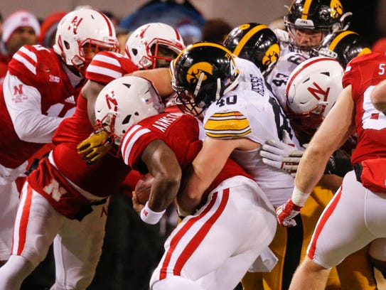 Iowa freshman defensive end Parker Hesse pulls down