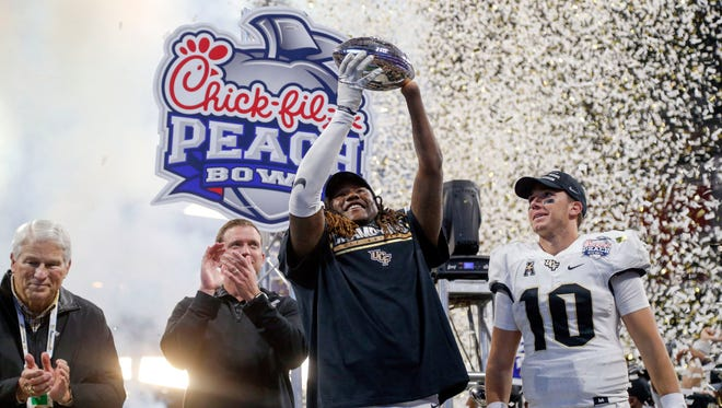 Central Florida Knights linebacker Shaquem Griffin (18) and quarterback McKenzie Milton (10) celebrate a victory against the Auburn Tigers in the 2018 Peach Bowl at Mercedes-Benz Stadium.