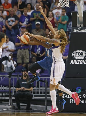 Mercury's Brittney Griner blocks Lynx's Sylvia Fowles at US Airways Center in Phoenix, AZ on August 23, 2015.