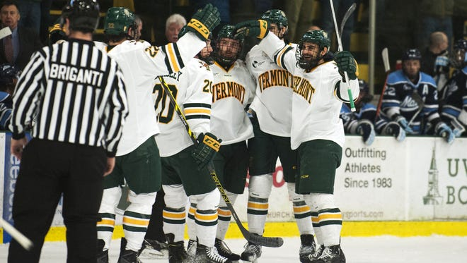 Vermont celebrates a goal during the Hockey East quarterfinal men's hockey game between the Maine Blackbears and the Vermont Catamounts at Gutterson Fieldhouse on Sunday night in Burlington.