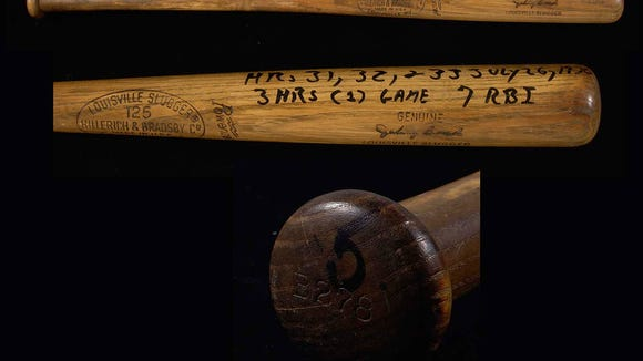 Items like this bat from Hall of Famer and former Reds