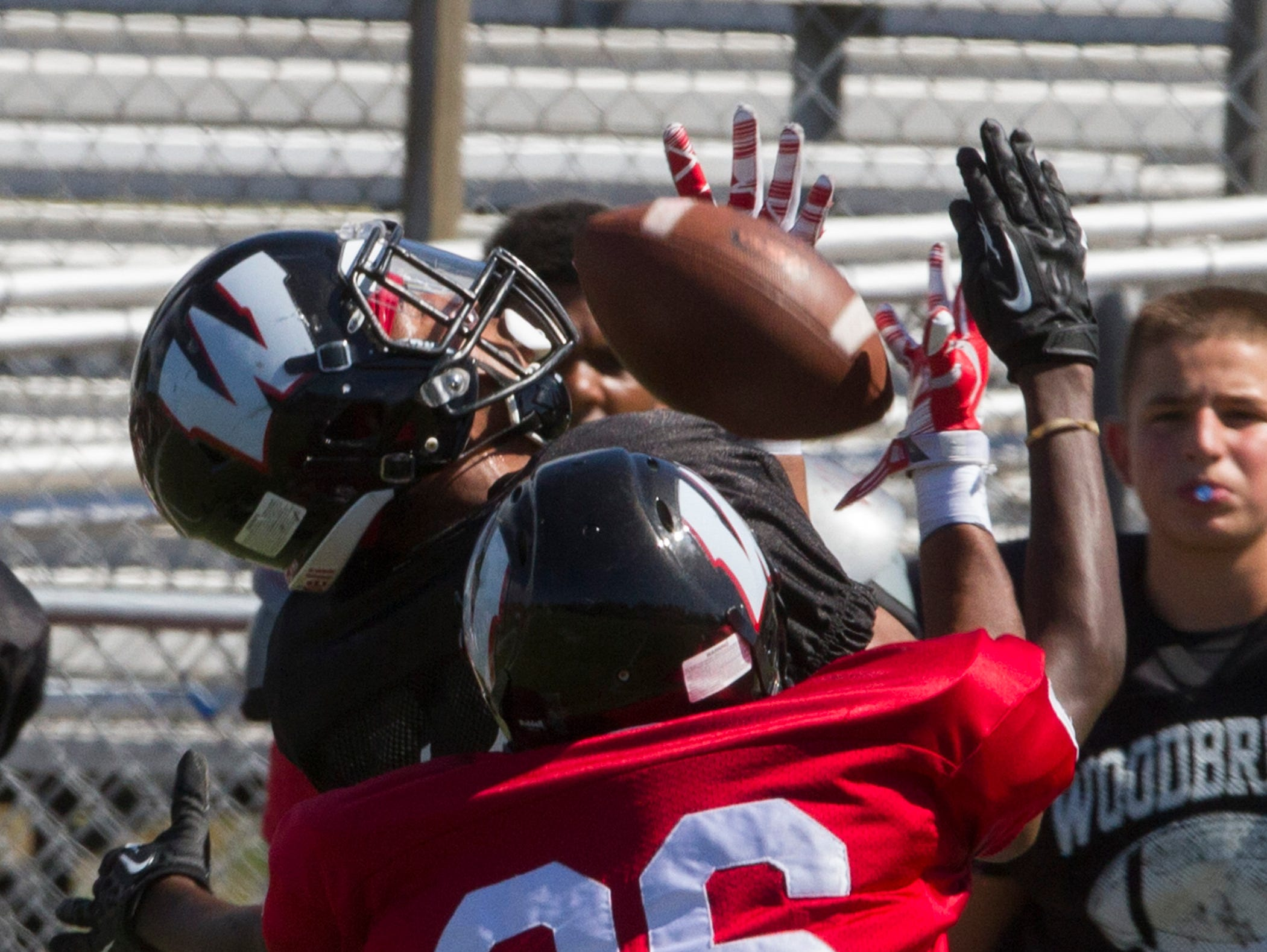 The black team's Quaasim Glover pulls in a long pass down the sideline as he's covered by red team's Dawud Lebron during the Black and Red Scrimmage at Woodbridge High School Footballin Woodbridge, NJ on August 22, 2015.