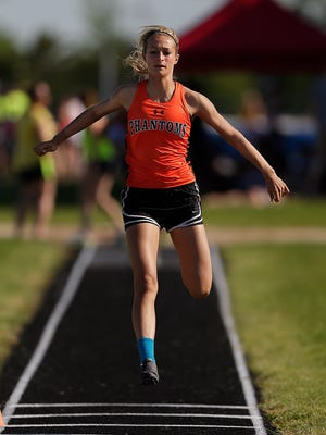 West De Pere's Crystal Hill warms up before competing in the girls triple jump during Thursday's WIAA Div.1 sectional track and field meet at Bay Port High School in Suamico. Hill qualified for state in the long and triple jump.