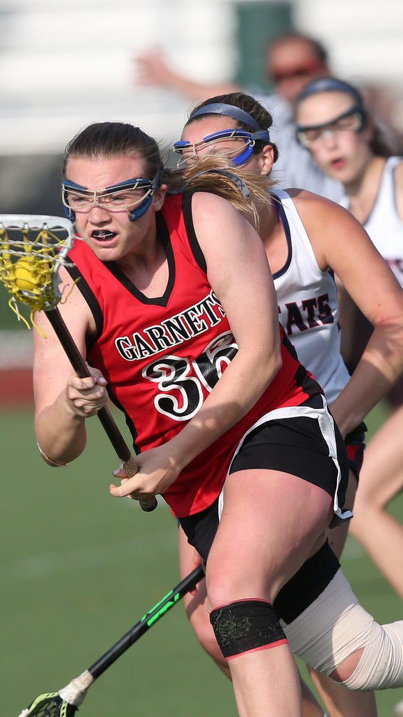 Rye's Margaret Mitchell (36) drives to the goal against Byram Hills during girls lacrosse action at Byram Hills High School in Armonk May 10, 2018. Rye won the game 13-12.