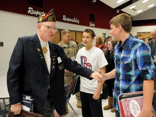 Veteran Don Christian of De Pere meets students Ethan