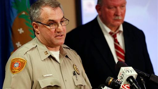 In this Friday, April 10, 2015, photo, Tulsa County Sheriff's Office Capt. Billy McKelvey, left, speaks next to Jim Clark, an independent consultant, during a news conference about the investigation of the death of Eric Harris in Tulsa, Okla. Police say a reserve sheriff's deputy thought he was holding a stun gun, not his handgun, when he fatally shot Harris during an arrest that was caught on video in Tulsa. (Cory Young/Tulsa World via AP)