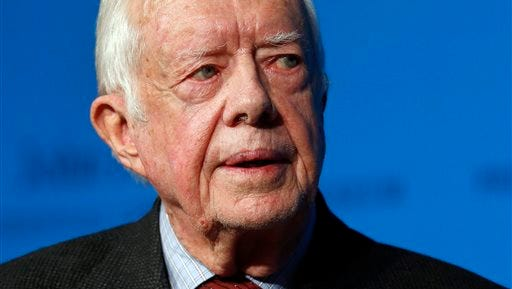 In this Thursday, Nov. 20, 2014 photo, former U.S. President Jimmy Carter speaks during a forum in Boston. On Wednesday, Aug. 12, 2015, Carter announced he has cancer and will undergo treatment at an Atlanta hospital.