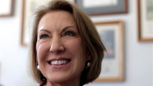 Republican presidential candidate Carly Fiorina talks to a restaurant patron during a campaign stop at the Starboard Market in Clear Lake, Iowa.