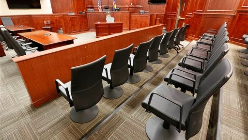 In this Jan. 15, 2015, file photo, the jury box is at right in Courtroom 201, where the jury later sat for the trial of Aurora movie theater shootings defendant James Holmes in Centennial, Colo. Months after the trial, jurors who served said they're still troubled by flashbacks and nightmares, survivor's guilt and hypervigilance that have made it impossible to return to their normal lives.