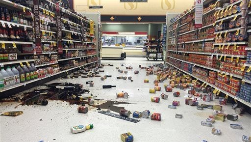 In this photo provided by Vincent Nusunginya, items fallen from the shelves litter the aisles inside a Safeway grocery store following a magnitude 6.8 earthquake on the Kenai Peninsula on Sunday Jan. 24, 2016, in south-central Alaska. The quake knocked items off shelves and walls in south-central Alaska and jolted the nerves of residents in this earthquake prone region, but there were no immediate reports of injuries. (Vincent Nusunginya via the AP)