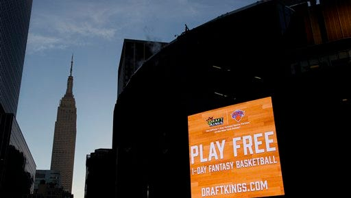 An electronic advertisement for DraftKings hangs on the side of Madison Square Garden, Wednesday, Jan. 6, 2016 in New York. Officials say a court could rule by mid-January in the legal spat between fantasy sports sites FanDuel and DraftKings over a state order to shut down their operations in New York. The companies have asked an appeals court to continue a temporary hold on Attorney General Eric Schneiderman's shutdown order. The companies argue their games are based on skill, not chance, and players pay entry fees in order to manage rosters like a general manager. But Schneiderman has countered that the games are highly dependent on factors out of their control, such as injuries or even the weather, and are thus ultimately based on chance.