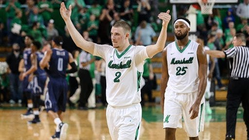 Marshall's Stevie Browning (2) celebrates as he and Ryan Taylor (25) exit the floor with a win over Old Dominion on Saturday, Feb. 20, 2016, at the Cam Henderson Center in Huntington, WV. (Sholten Singer/The Herald-Dispatch via AP)