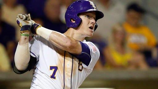 LSU's Greg Deichmann watches his three-run home run during the fourth inning of an NCAA college baseball tournament super regional game against Coastal Carolina in Baton Rouge.