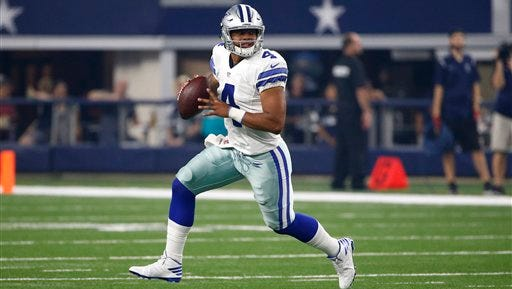 Dallas Cowboys quarterback Dak Prescott runs the ball against the Miami Dolphins in the first half of an NFL preseason football game, Friday, Aug. 19, 2016, in Arlington, Texas.