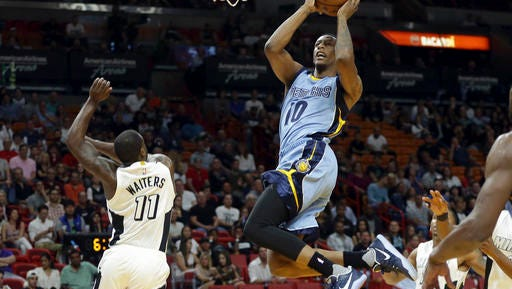Memphis Grizzlies forward Troy Williams (10) drives to the basket as Miami Heat guard Dion Waiters (11) defends during the first half of an NBA basketball game, Saturday, Nov. 26, 2016, in Miami. (AP Photo/Lynne Sladky)