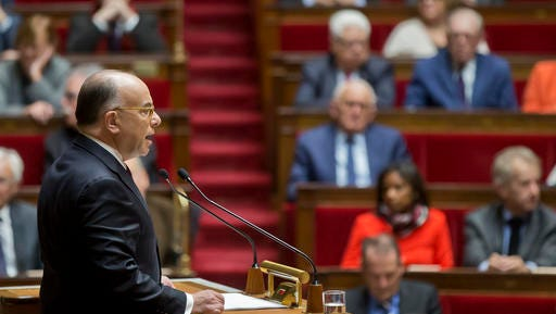 France's Prime Minister Bernard Cazeneuve speaks at the National Assembly in Paris, Tuesday, Dec. 13, 2016. France's new Prime Minister Bernard Cazeneuve has given his first speech to parliament, arguing for an extension of a year-old state of emergency to keep France secure through presidential elections.
