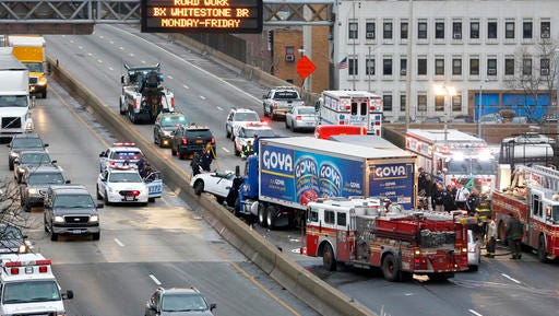 FILE - In this Dec. 27, 2016 file photo, emergency personnel work at the scene of a fatal multi-vehicle crash on the eastbound side of the Bronx Expressway in the Bronx section of New York. The government says traffic fatalities surged about 8 percent in the first nine months of last year, continuing an alarming upward spiral that began in late 2014. The National Highway Traffic Safety Administration said the sharp increase comes at the same time Americans are putting more miles on the road than ever before. But the rise in deaths is outpacing the increase in travel. Vehicle miles traveled in the first nine months of 2016 increased about 3 percent.
