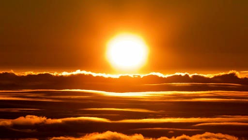 The sun rises over the clouds in front of the summit of Haleakala volcano in Haleakala National Park on Hawaii's island of Maui, Sunday, Jan. 22, 2017. Park officials say the sunrise on Haleakala attracts over a thousand people a day, resulting in an overload of visitors and creating a safety hazard. As a result, anyone wanting to see the sunrise on the summit will now be required to make reservations in advance and pay a small fee.