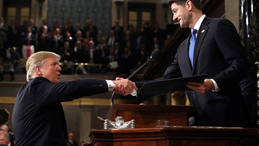 President Donald Trump shakes hands with House Speaker Paul Ryan of Wis., as he arrives on Capitol Hill in Washington, Tuesday, Feb. 28, 2017, for his address to a joint session of Congress. (Jim Lo Scalzo/Pool Image via AP)