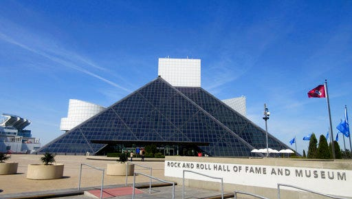 FILE – This April 24, 2016, file photo shows the Rock and Roll Hall of Fame and Museum, located on the shores of Lake Erie in downtown Cleveland. The Rock and Roll Hall of Fame will celebrate 50 years of Rolling Stone magazine in a new exhibit set to open this spring in Cleveland. Highlights of cover images reaching back to rock 'n' roll pioneers such as Elvis Presley and Chuck Berry also will be included in the exhibit that opens May 5, 2017.