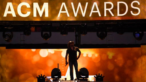 FILE - In this April 19, 2015 file photo, Jason Aldean performs at the 50th annual Academy of Country Music Awards at AT&T Stadium in Arlington, Texas.   The ACM Awards, airing Sunday, April 2, 2017 on CBS  are relying on two likable co-hosts, tried and true stars of the format, cross-genre collaborations, a party vibe and new music to keep fans tuned in.
