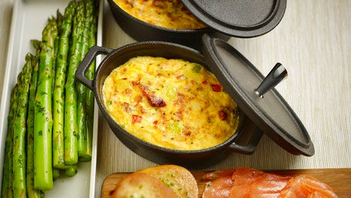 This April 3, 2017 photo provided by The Culinary Institute of America shows a spring leek frittata in Hyde Park, N.Y. This dish is from a recipe by the CIA.