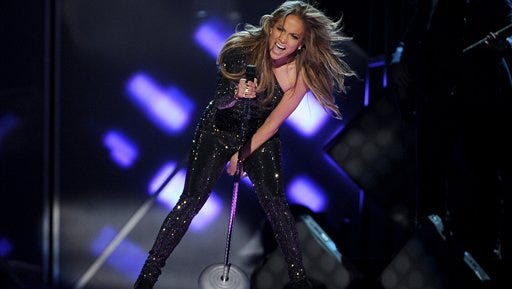 Jennifer Lopez performs on stage at the Billboard Music Awards at the MGM Grand Garden Arena. FIFA officials say Jennifer Lopez won?t be performing the World Cup song along with co-artists Pitbull and Claudia Leitte in the opening ceremony of the 2014 World Cup on Thursday.
